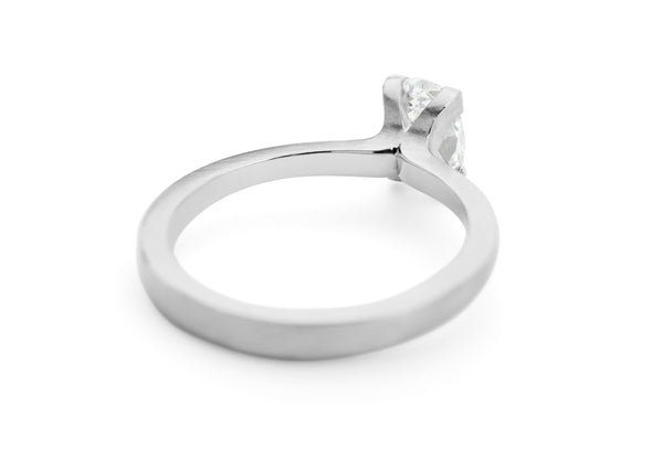 Platinum 4-claw talon engagement ring with oval white diamond