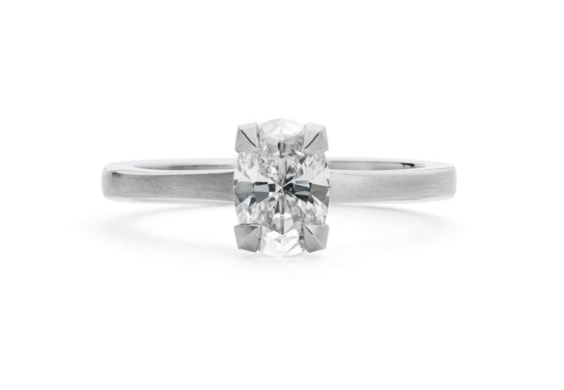 Platinum four claw talon engagement ring with oval white diamond-McCaul