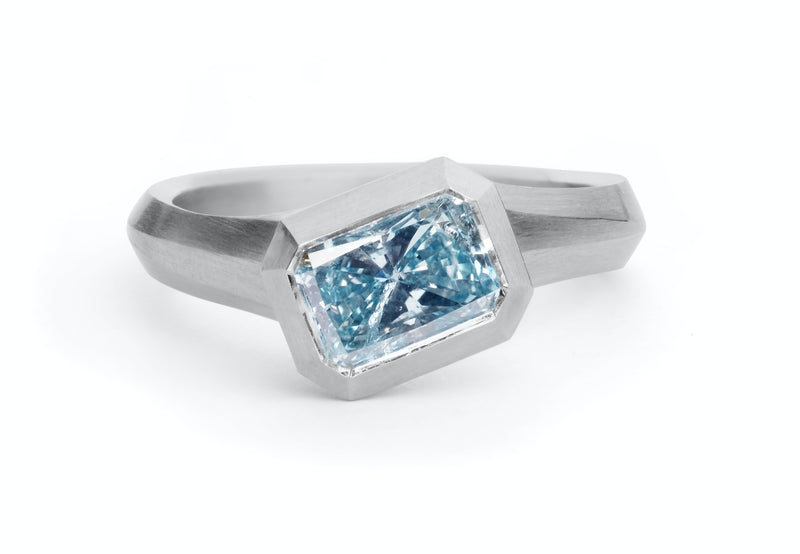 modern blue diamond engagement ring