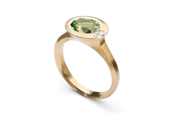 Rose gold Arris ring with oval tsavorite garnet and white diamonds