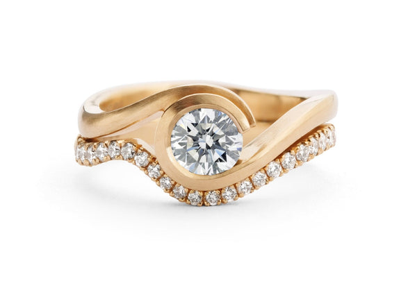 Rose gold and white diamond Wave engagement ring with fitted diamond wedding band