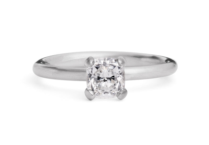 SCULPTED PLATINUM 4 CLAW DIAMOND ENGAGEMENT RING WITH CUSHION SHAPED DIAMOND