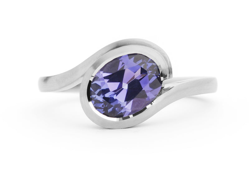 Wave dress or engagement ring in platinum with oval tanzanite