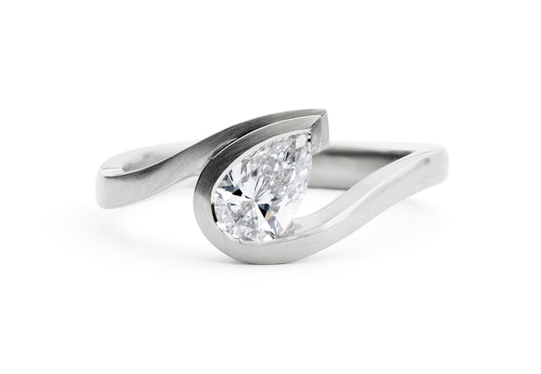 Wave-ring-platinum-pearshape-white-diamond
