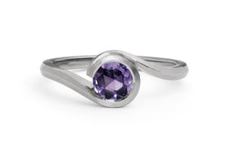 Platinum and violet sapphire wave engagement ring