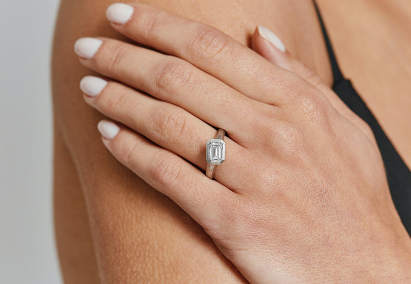 Arris modern platinum engagement ring with emerald-cut white diamond-McCaul