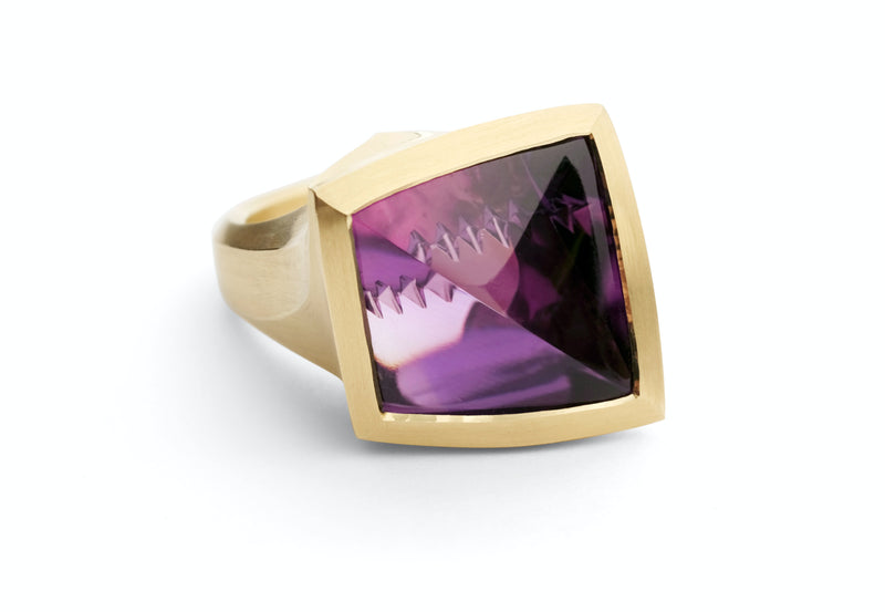 Arris: Fancy cut 16 carat amethyst set in yellow gold.-McCaul