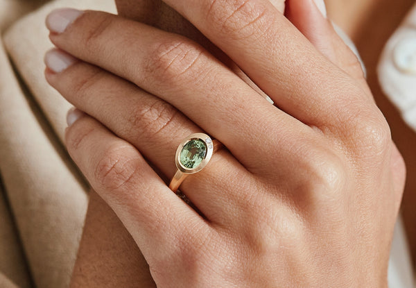 Rose gold Arris ring with oval tsavorite garnet and two white diamonds-McCaul