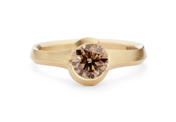 Hand carved rose gold Arris ring with round cognac diamond