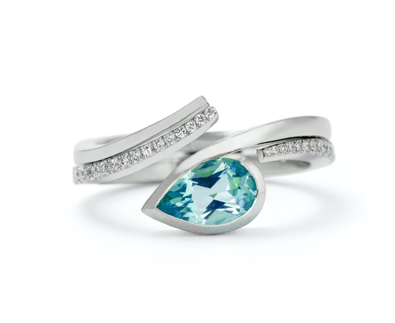 Hand forged platinum and pear shaped paraiba ring