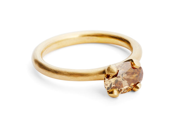 Modern rose gold engagement ring with oval cognac diamond