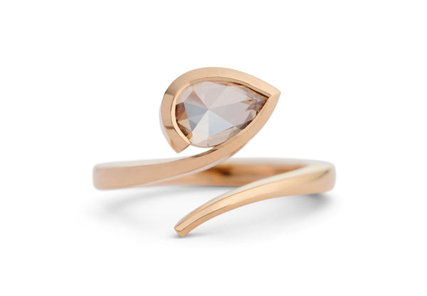 Contemporary rose gold and rose cut champagne diamond engagement ring
