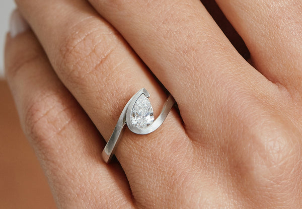 Wave platinum pear shape diamond engagement ring-McCaul