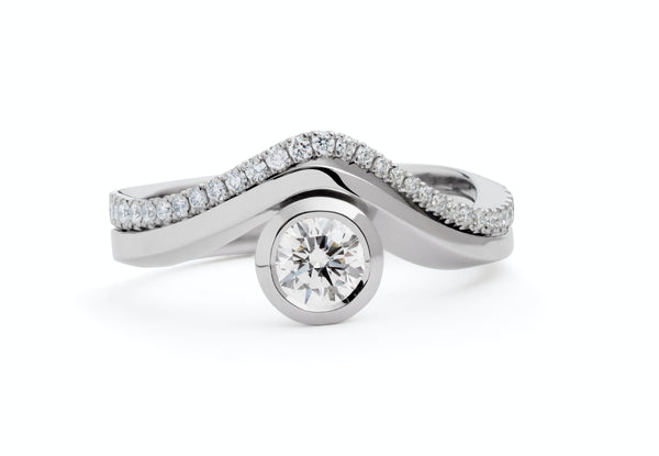 'Balance' platinum engagement ring with matching wedding band
