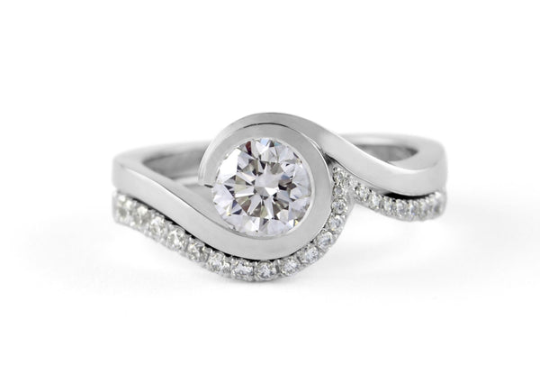 Contemporary platinum 'Wave' engagement ring with brililant white diamonds