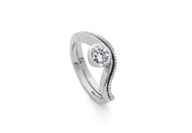 Balance platinum and diamond engagement ring with fitted wedding band