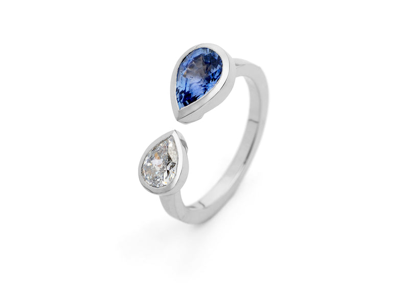 Unique platinum two stone engagement ring with pear diamond and sapphire