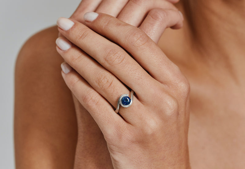 Platinum and blue sapphire Wave engagement ring-McCaul
