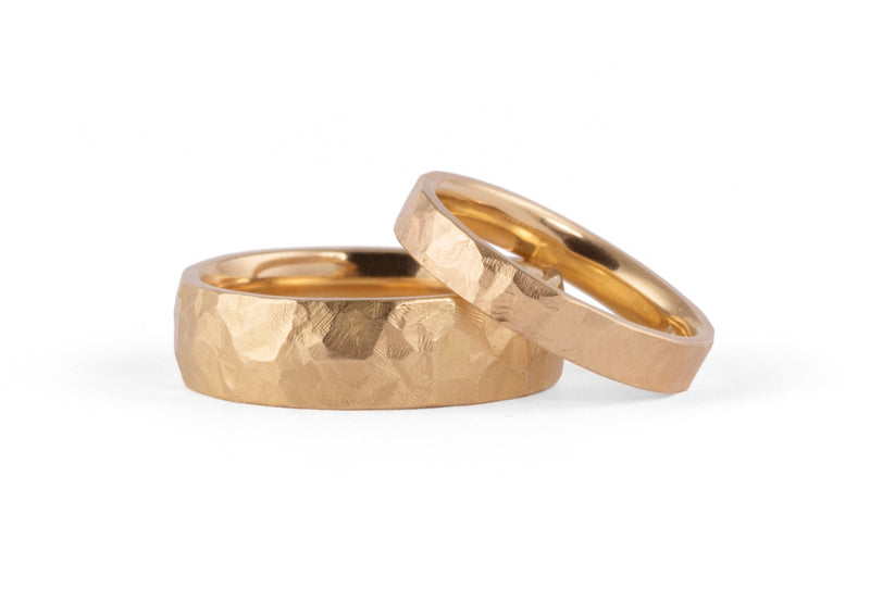 Rose gold hammered wedding rings for men and women