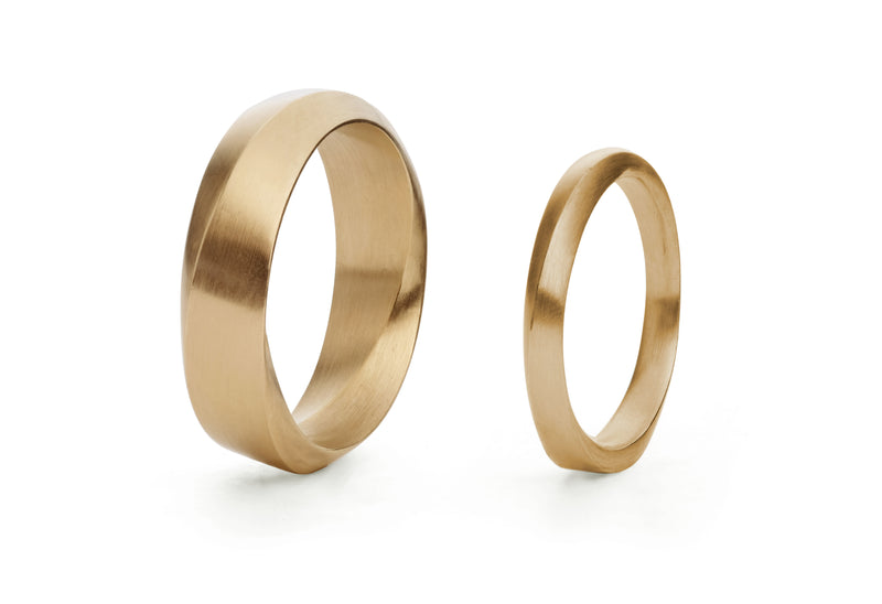 Ladies and mens mobius wedding bands