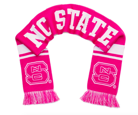 A pink scarf with NC State in large lettering and the college letter logo NCS