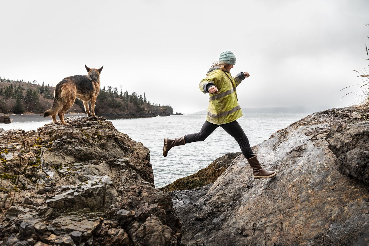 Woman hikes in Legacy Boots with her German Shepard dog