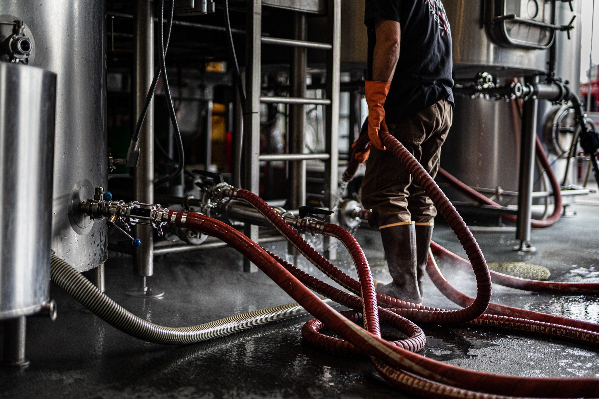 Wide Ride brewer working with red hose