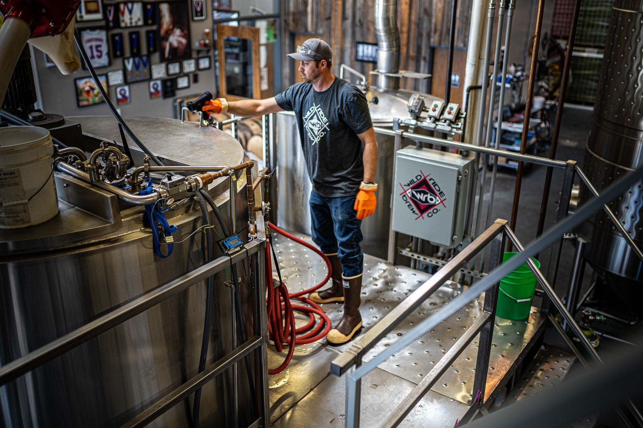 Wild Ride Brewer working on metal brew deck