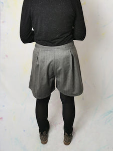 These awesome high waisted shorts are a super flattering, comfortable shape. Handmade with contrast pockets and vintage buttons for a pop of colour and personality. Upcycled, reworked fashion. Re-purposed fabrics. #Sustainablefashion #reuse