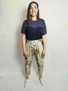 These awesome peg leg trousers are a super flattering, comfortable shape. Handmade with contrast pockets and vintage buttons for a pop of colour and personality. Upcycled, reworked fashion. Re-purposed fabrics. Collect Me Fashion #Sustainablefashion #reuse #vintagefashion