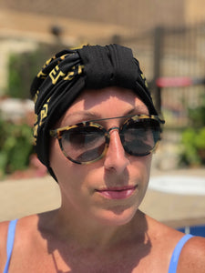 "AQUA Waterproof Headwear, Luxe Banded Turban in Gold and Black ""Baller Rings"" Print"