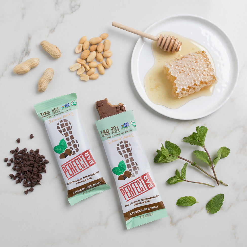 Chocolate Mint bar laying on counter with peanuts, chocolate chips and mint