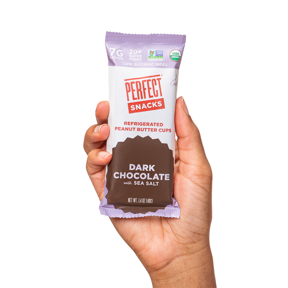 Hand holding Dark Chocolate with sea salt cup