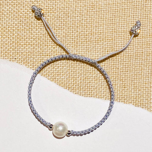 STRING AND PEARL BRACELET