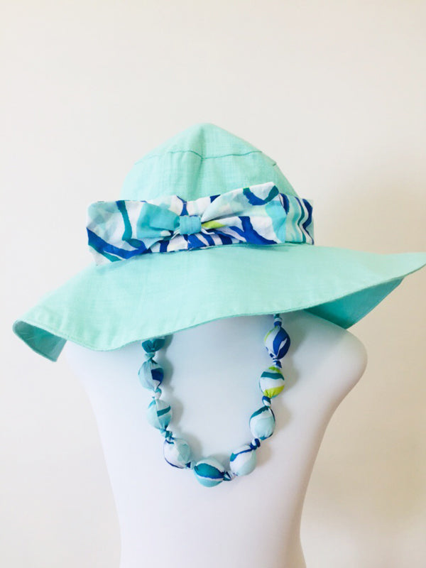 Tiki sunhat in aqua cotton linen with bow