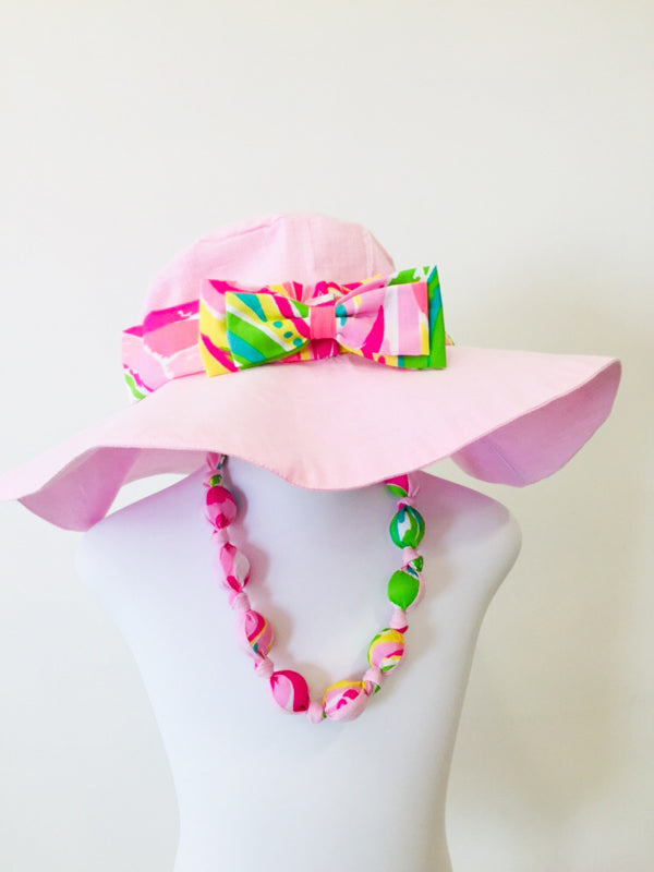 Tiki sunhat in pink cotton linen with bow