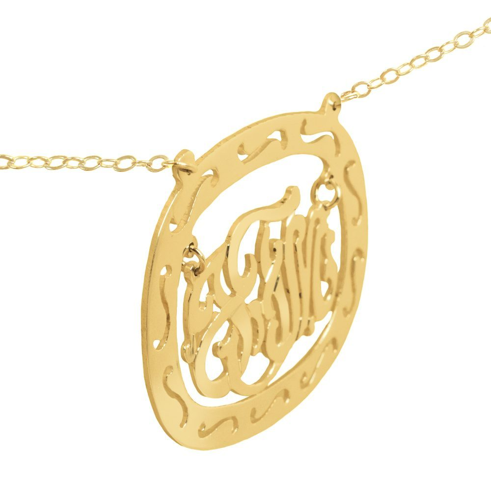 14K gold-plated silver oval monogram necklace inside thick patterned circular frame Angle