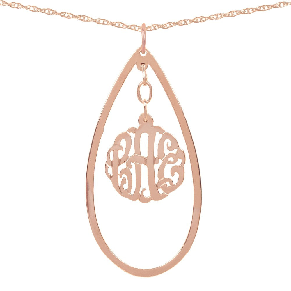 24k rose-gold-plated silver necklace with monogram hanging inside a hollow teardrop pendant