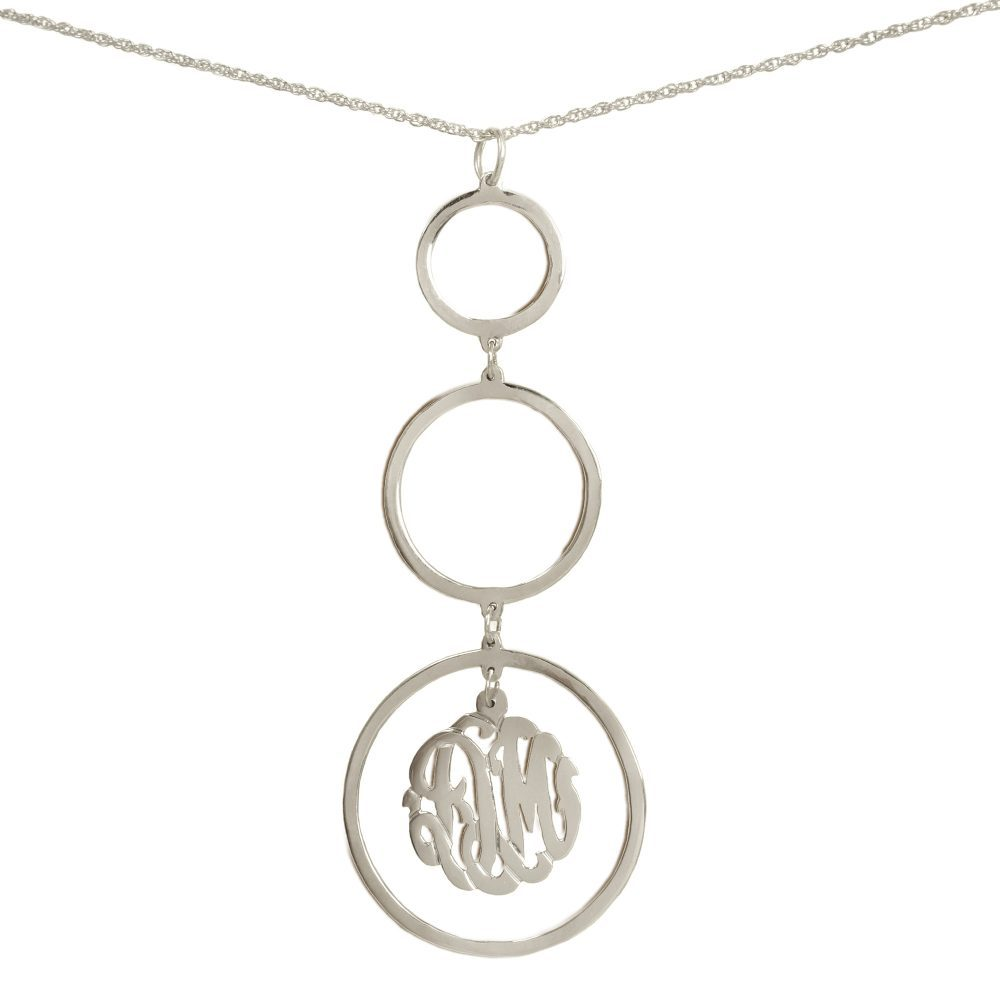silver necklace with three hanging circular pendants with a monogram inside bottom pendant