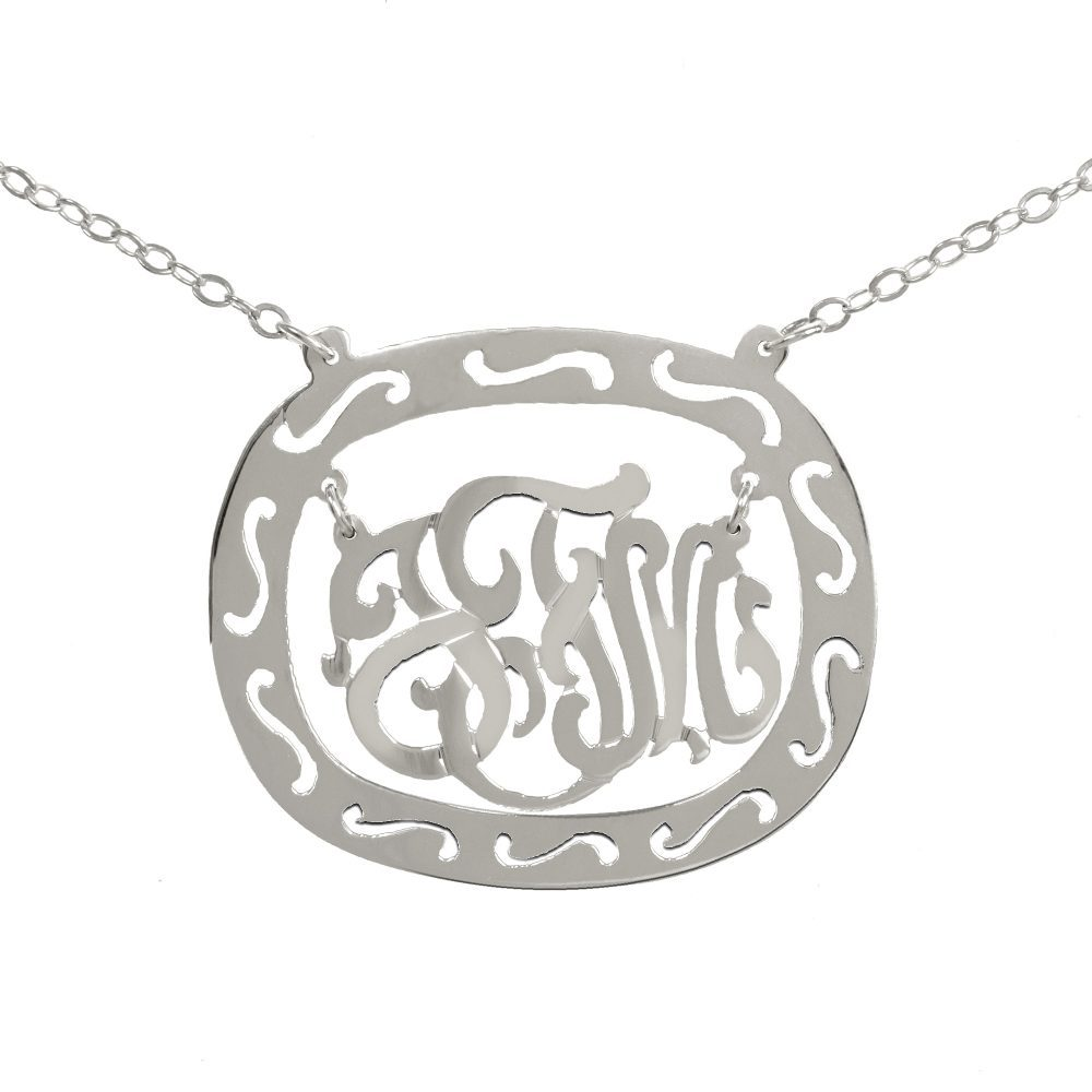 silver oval monogram necklace inside thick patterned circular frame