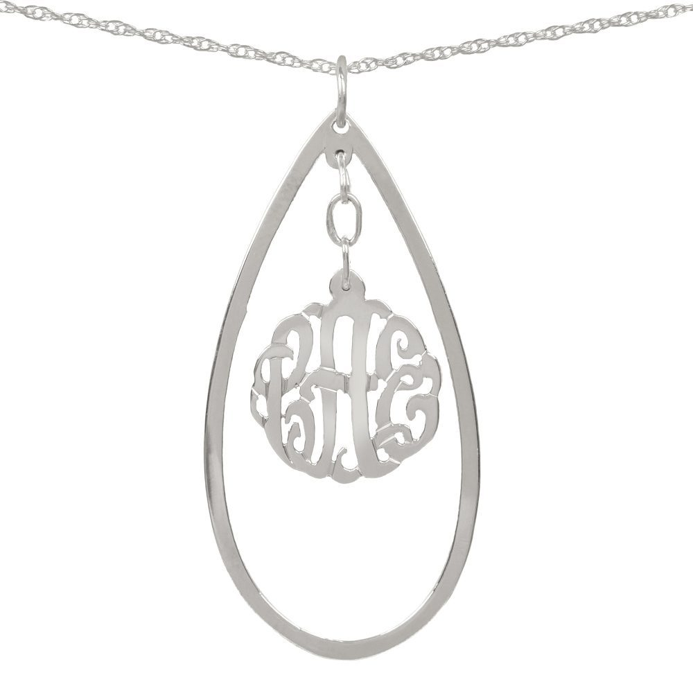 silver necklace with monogram hanging inside a hollow teardrop pendant