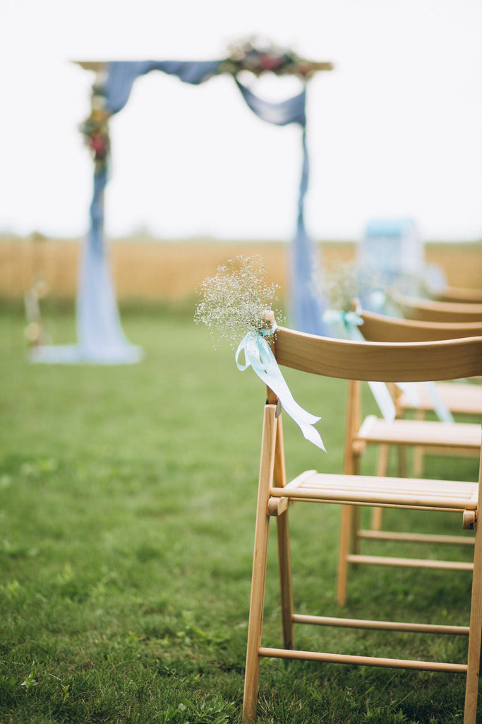 Dusty blue wedding ceremony arch