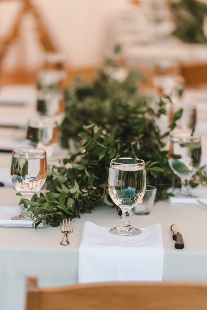 Beautiful green garland for table centerpieces at wedding by Laura Robinson Photography