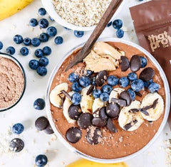 Chocolate protein fluff with peanut butter and blueberries