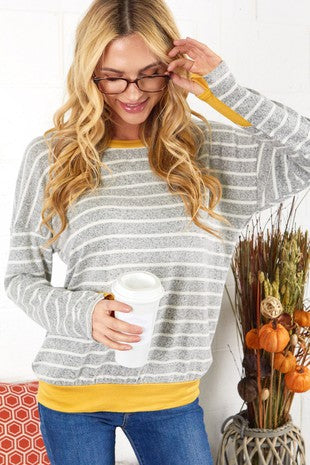 soft grey and mustard pullover