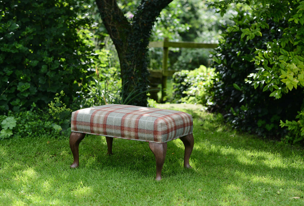 Handmade footstool and ottoman upholstered in plaid wool fabric
