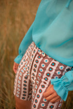 Anita is 60s Brown & Turquoise Floral Short
