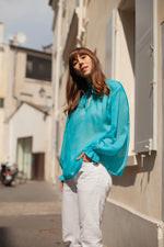 Anita is Vintage 60s Turquoise Long Sleeve Blouse with Ruffle Collar