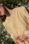 Anita is Vintage 60s Yellow Lace Long Sleeve Mini Dress