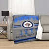 A blanket throw reversible to sherpa with the Winipeg Jets logo